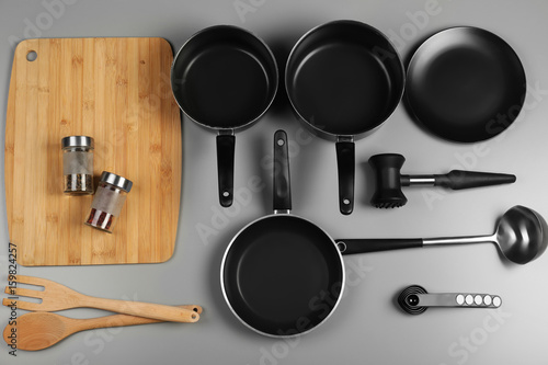 Kitchen utensils for cooking classes on color background
