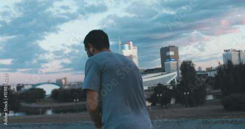 Caucasian male jogging in the city, urban background. 4K UHD RAW edited footage © daniilvolkov