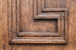 Old brown wooden wall with decorative pattern
