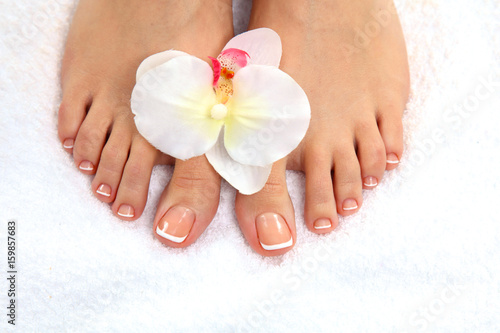 Foto op Canvas Pedicure Closeup photo of a beautiful female feet with pedicure