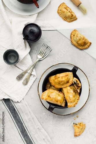 Homemade Empanadas in Rustic Bowl on Kitchen Table - 159896284