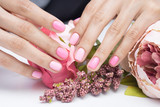 Women's hands and amazing natural nails. Ideal manicure with gel polish and nail art.