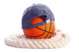 Basketball, cap and rope on a white background