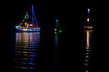Christmas Sailboats in Nighttime Flotilla - 159995203