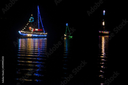 Christmas Sailboats in Nighttime Flotilla Poster