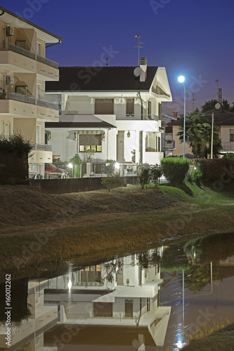 Venice, Italy, June, 9, 2017: night landscape with the image of channel in Rovigo, Italy