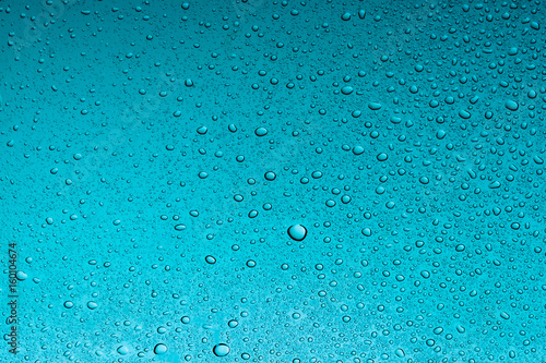 Teal water drops abstract background