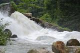 The waterfall is swiftly slammed by rocks