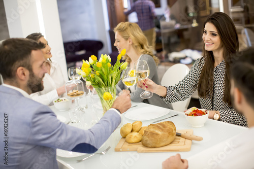 Young friends having dinner at home and toasting with white wine - 160126267