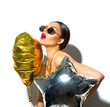 Party. Beautiful fashion model girl with colorful heart and star shaped balloons isolated on white background