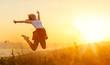 Leinwanddruck Bild - Happy woman  jump,  rejoices,  on sunset in nature