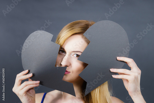 Young sad woman covered by broken heart. Poster