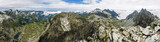 Summer panorama of mountains - valleys and ridges.