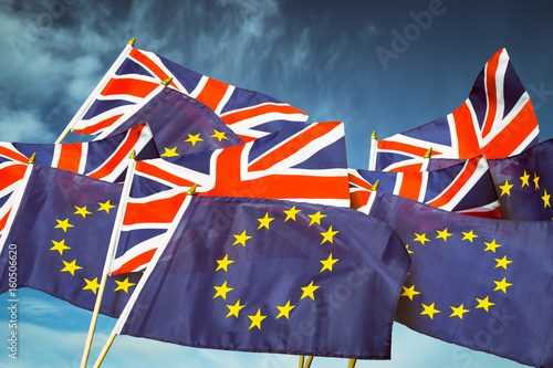 European Union and British Union Jack flag flying in front of bright blue sky in Poster