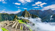 Overview of Machu Picchu, agriculture terraces and Wayna Picchu peak in the background