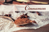 Spoon with powdered cinnamon on paper