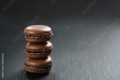 Foto op Aluminium Macarons chocolate macarons stacked on slate board