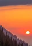 Sunset on the mountainside, orange sky
