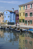 BURANO - ITALY, APRIL 18, 2009: Panoramic view of colorful buildings and boats in front of a canal at Burano, a gracious little town full of canals, near Venice.