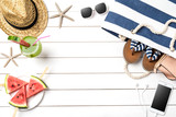 Summer background with watermelon, beach bag and accessories