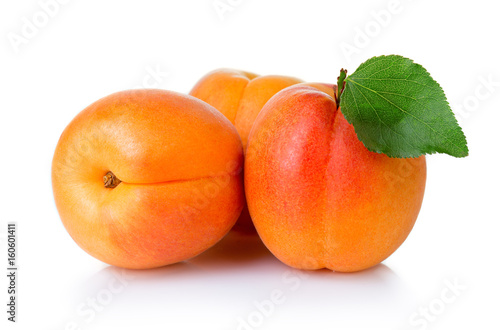 Ripe apricot fruits with green leaf isolate on white - 160601411