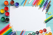 Quadro school and office supplies. school background. colored pencils, pen, pains, paper for  school and student education on blue wood background. top view with copy space