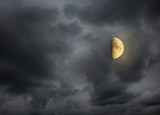Moon in the night cloudy sky
