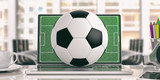 Football ball on a laptop - office background. 3d illustration - 160634230