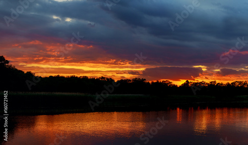 sunset in the river with reflex