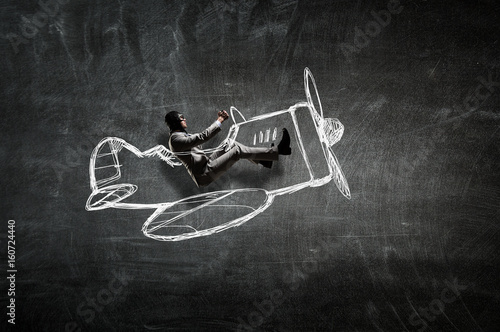 Aviator in retro plane. Mixed media