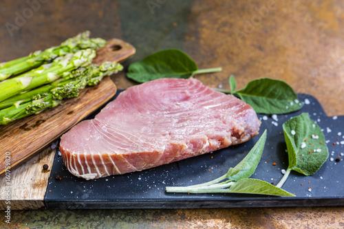 Fresh tuna steak with herbs and green asparagus. - 160759820