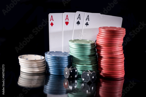poker chips and play card isolated on black Poster