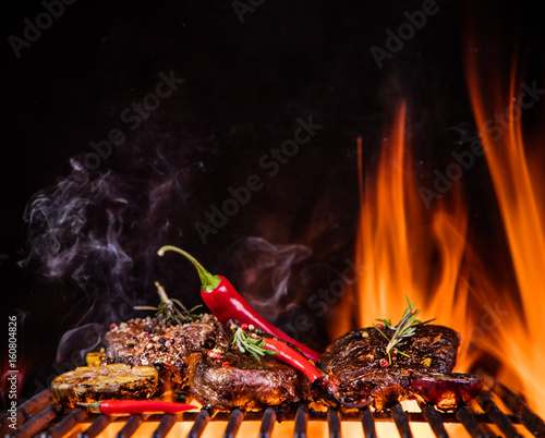 Beef steaks on the grill with flames - 160804826