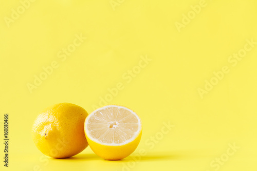 Yellow lemon cutted half on table with pattern