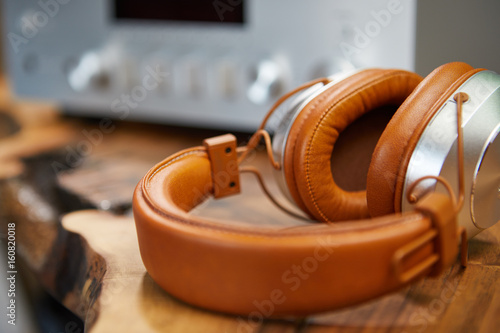 Plakát Vintage Headphones lie on a wooden table