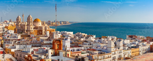 Leinwanddruck Bild Aerial panoramic view of the old city rooftops and Cathedral de Santa Cruz in the morning from tower Tavira in Cadiz, Andalusia, Spain