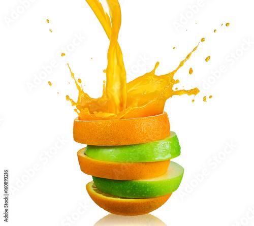 green apple and splashing orange juice