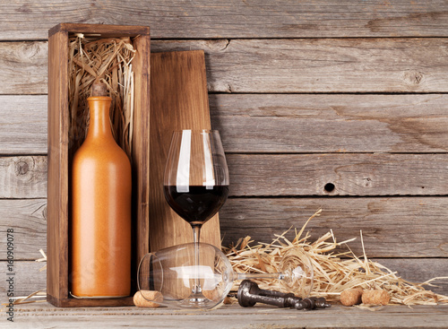 Red wine bottle and wine glasses