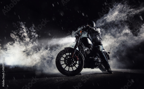 High power motorcycle chopper with man rider at night