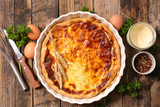 quiche with ingredient on wooden background