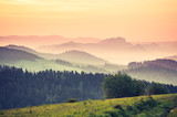 Moments before sunrise in misty Carpathian mountains, spring, Poland