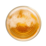 Top view of amber colored beer with foam and bubbles in simple glass. - 160930619
