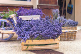 Lavender for sale close-up.Assembled lavender on sale in wooden boxes and a basket.A lot of lavender on sale. Lavender flowers.