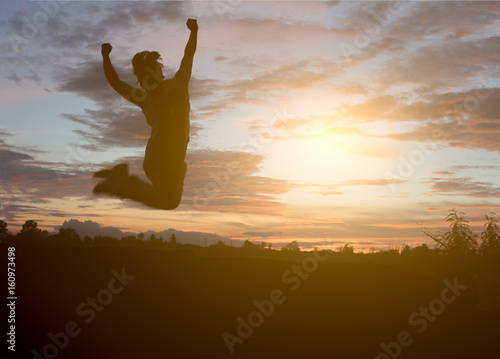 Man in the sunset, happy and jumps. Poster
