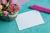 Blank notebook on aquamarine background
