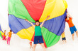 Kid boy standing under tent made of parachute - 160974865