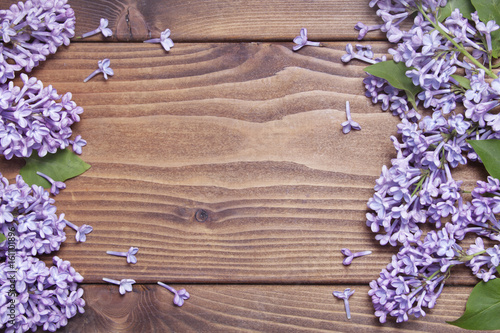 Wooden background with lilac flowers