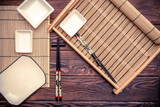 Sushi accessories on a brown wooden background
