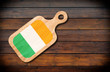 Concept of Irish cuisine. Cutting board with a Ireland flag on a wooden background - 161115839