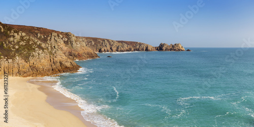 Turquoise sea at Porthcurno Beach in Cornwall, South England Poster